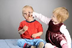 Girl feeding boy Stock Photography