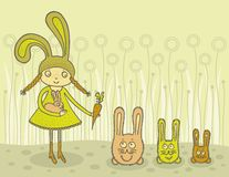 Girl feeding bunnies Royalty Free Stock Photo