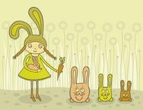 Girl feeding bunnies Royalty Free Stock Photo