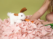 Girl feeding carrots to Easter Bunny Stock Photo