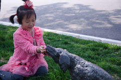 Girl feeding the dog sculpture. Stock Photo