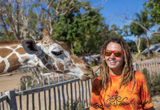 Girl Feeding Giraffe at Zoo Royalty Free Stock Image