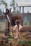 Girl feeding her horse Royalty Free Stock Photography