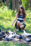 Girl feeding pigeons Royalty Free Stock Image
