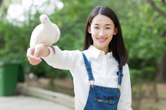 Girl Feeding Pigeons Stock Photos
