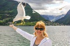 Woman enjoy seagull Stock Photography
