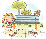Girl Feeding Sparrows In The Park Royalty Free Stock Images
