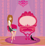 Girl feeds a cat in the house. Illustration Stock Photo