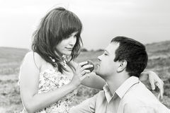 The girl feeds the husband Royalty Free Stock Photos