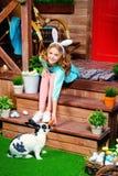 Girl feeds a rabbit