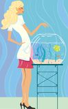 The girl feeds small fishes Stock Image
