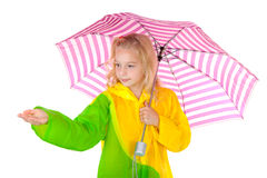 Girl feel if it is raining. Blonde girl standing under umbrella feel if it is raining over white background Stock Image