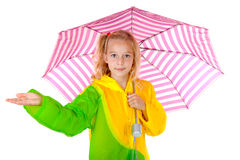 Girl feel if it is raining. Blonde girl standing under umbrella feel if it is raining over white background Royalty Free Stock Images