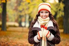 Girl feeling cold in autumn park. Beautiful girl freezing in autumn park Royalty Free Stock Photos