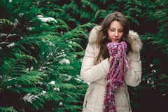 Girl is feeling cold in winter. Girl is feeling cold in snowy forest Royalty Free Stock Photography