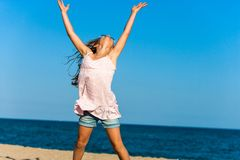 Girl feeling free at seaside. Stock Photo