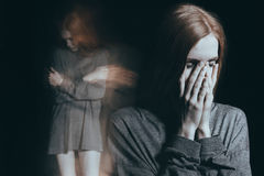 Girl feeling overwhelming loneliness Royalty Free Stock Photo