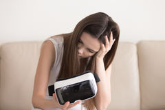 Girl feels dizzy after using VR glasses, virtual reality sicknes Stock Image