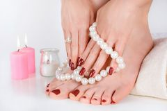 Free Girl Feet And Hands With Dark Red Color Manicure And Pedicure Stock Photography - 151766162