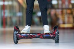 Girl feet on the hover board. Self-balancing scooter or mini segway. Royalty Free Stock Photography