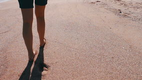 Girl feet leave footprints on the beach stock video footage