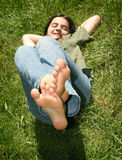 Girl feet raised outdoors Stock Photos