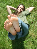 Girl with feet raised Stock Photography