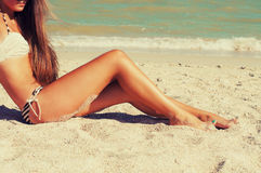 Girl feet in the sand on the beach Royalty Free Stock Photo