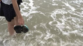 Girl feet standing on a Beach with wave crushing stock video
