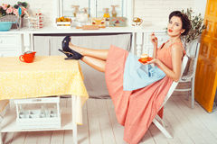 Girl with feet on the table. Royalty Free Stock Photos