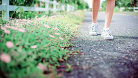 Girl feet walking on the road Royalty Free Stock Image