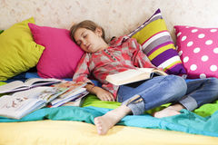 Girl fell asleep Stock Images