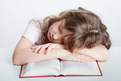 Girl fell asleep with a book Stock Photography
