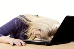 Girl fell asleep on the laptop Royalty Free Stock Image