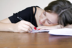 Girl Fell asleep on office desk Royalty Free Stock Photography