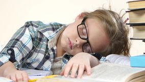 Girl fell asleep at the table and her dreams. White background. Close up stock footage