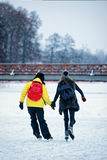 Girl and fellow ice skating in Trakai Lithuania Stock Photo