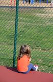Girl and fence Royalty Free Stock Image