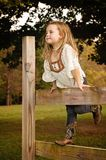 Girl on fence Royalty Free Stock Photography