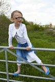 Girl on the fence Royalty Free Stock Photography