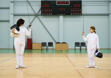 Girl fencer with trainer Royalty Free Stock Photography