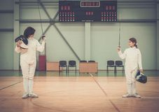 Girl fencer and with trainer Stock Photography