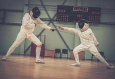 Girl fencer and with trainer Royalty Free Stock Photography