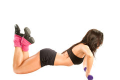 Girl with a few dumbbells pressed Stock Photography