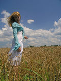Girl in field. Field of Wheat royalty free stock photos
