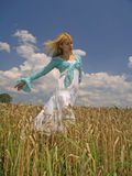 Girl in field. Field of Wheat royalty free stock photo