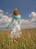 Girl in field. Field of Wheat stock photography