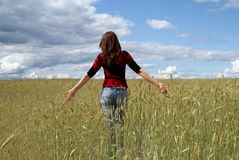 A girl is in the field. Wheat. On sky of cloud Stock Images
