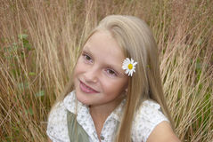 Girl in the field. A small blond girl in the field royalty free stock photography
