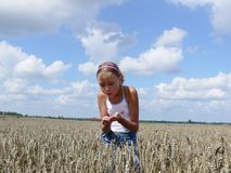 Girl in field. Of wheat checks grain Royalty Free Stock Photography